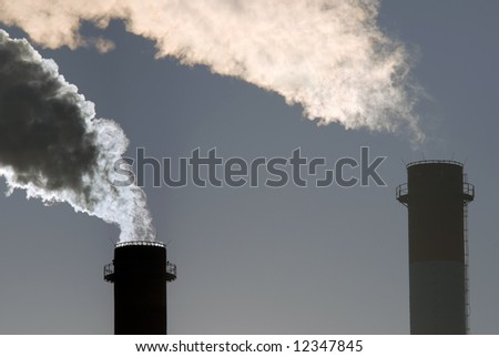 Dangerous toxic CO2 clouds from industrial chimneys, close-up