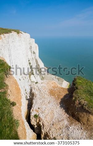 Dangerous white cliffs of Dover drop - stock photo