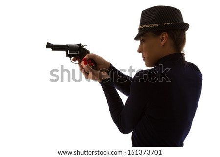 Dangerous woman in black with big handgun and stylish hat silhouette - stock photo