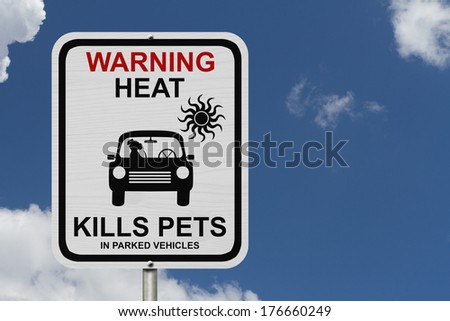 Dangers of leaving a dog in parked cars, A white road sign with the message of the danger with blue sky - stock photo