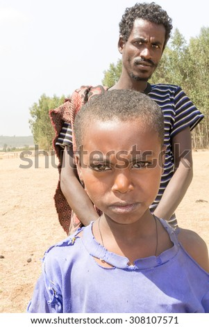 Dangla, Ethiopia - February 13, 2015: Close up picture of thea young boy staying by the road. Picture was taken when riding on the road near Dangla in Ethiopia.
