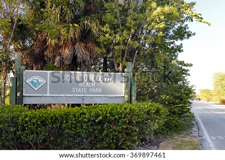 Dania Beach, FL, USA - December 20, 2014: Entrance sign to John U. Lloyd Beach State Park with a small sign that says Florida Park Service Environmental Protection