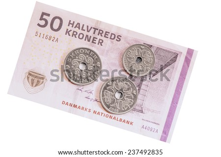 Danish coins on the fifty krones banknote background. - stock photo