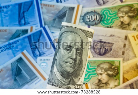 Danish crowns. Currency from Denmark in Europe. And dollar bills. - stock photo