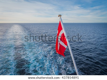 Danish flag hanging from a ship