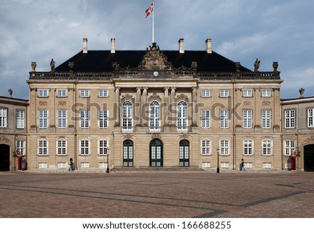 Danish Royal palace, Amalienborg castle residence of the Queen of Denmark in the capital copenhagen. Historical landmark and tourist attraction - stock photo