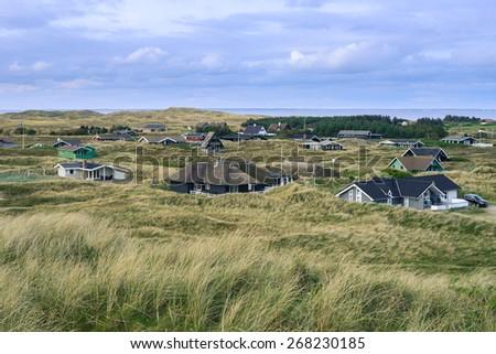 Dannish lanscape at surroundings of Hvide Sande. Resort cottages - stock photo