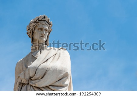 Dante Alighieri's statue in Florence in blue sky - stock photo
