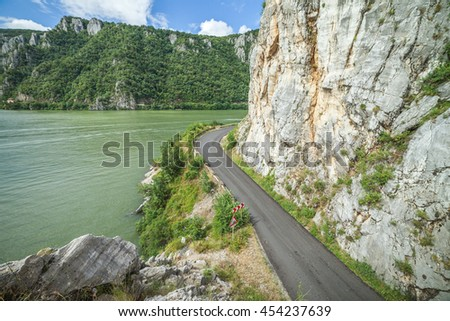 Danube river and road near big rock face mountain