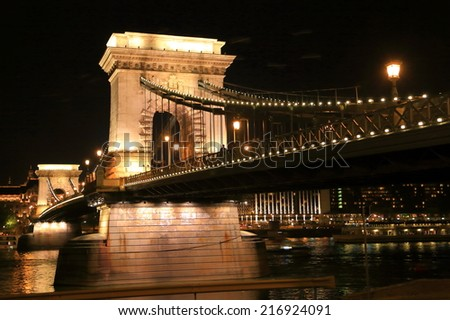 Danube river and shining lights on the Chain bridge at night, Budapest, Hungary - stock photo