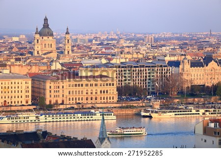 Danube river banks with traditional buildings and St Stephen church dome, Budapest, Hungary - stock photo
