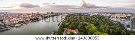 Danube River in City of Bratislava. Petrzalka Suburb on the Right Bank of the River at Sunset - stock photo