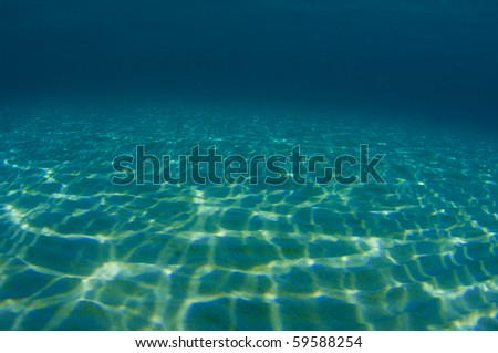 Dappled sunlight on sandy bottom.  Picture taken in south east Florida. - stock photo