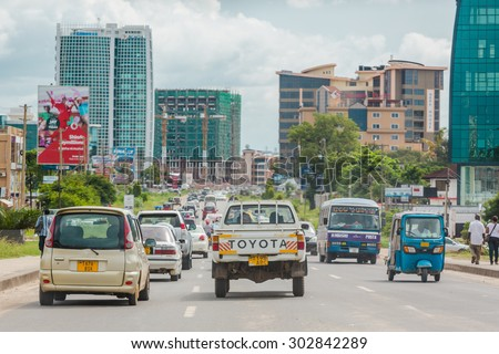 Dar Es Salaam: April 22: Traffic slows down travellers on the busy streets of Downtown Dar Es Salaam on April 22, 2015 in Dar Es Salaam, Tanzania - stock photo