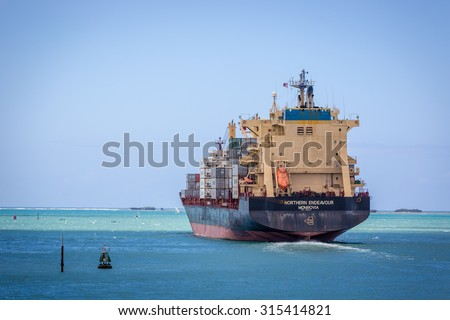 DAR ES SALAAM AREA, TANZANIA - AUGUST 9, 2015: Big vessel carrying hundreds of containers in the Dar es Salaam area, Tanzania, Africa