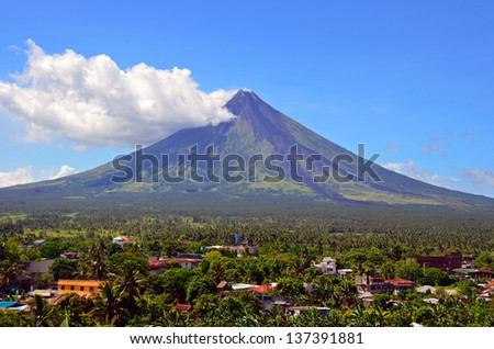 DARAGA, PHILIPPINES - APRIL 14: Mayon Volcano on April 14, 2013 in Daraga, Philippines. Mayon Volcano is an active volcano and 2462 meters high. - stock photo