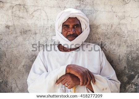DARAW, EGYPT - FEBRUARY 6, 2016: Portrait of local camel salesman in white clothes and turban. - stock photo