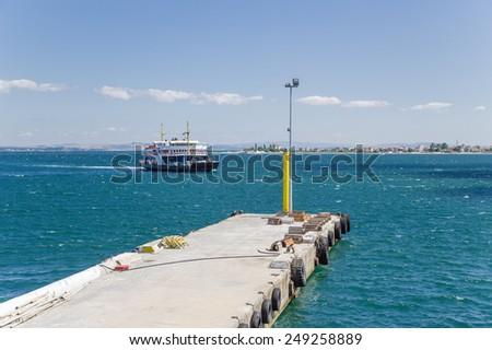 DARDANELLES, TURKEY - JUN 29, 2014: Photo of car ferry approaching the jetty - stock photo