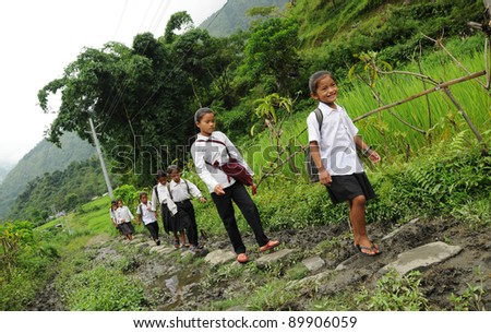 DARJEELING, INDIA - OCTOBER 27: Small unidentified children go home from school in Darjeeling on October 27, 2010. Education has been made free for children for 6 to 14 years of age in India. - stock photo