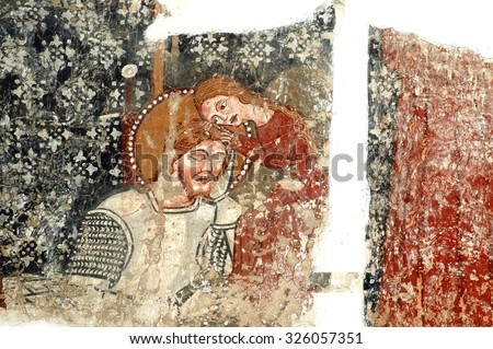 DARJIU, ROMANIA - MAY 12, 2008: The 13th century murals of the church of Szekelyderzs, discovered during a restoration, present the legend of the Hungarian King Saint Ladislaus - stock photo