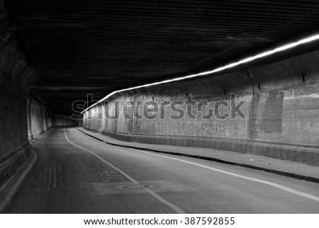 dark abandoned tunnel - stock photo