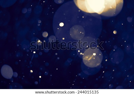 dark abstract blue bokeh defocused background - stock photo