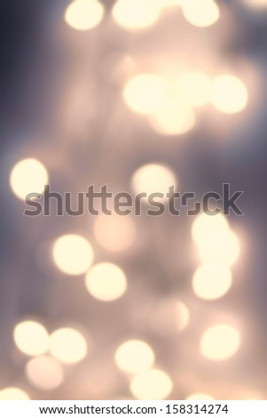 Dark Abstract Lights Festive  Sparkling  background with defocused  texture. Abstract night  twinkled bright background with bokeh lights