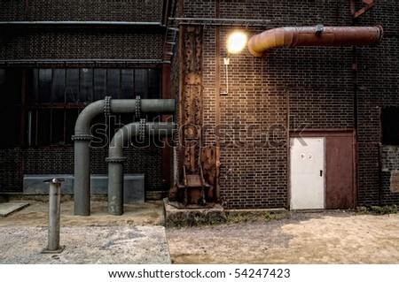 Dark alley in Zollverein - stock photo
