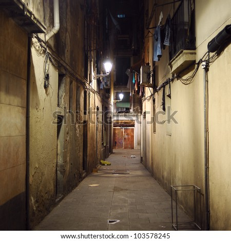 Dark alley, Seville, Spain - stock photo