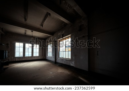 Dark and abandoned interior of a power plant - stock photo