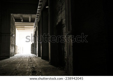Dark and abandoned interior of a power plant