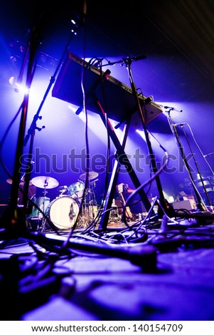 Dark and grainy image of a stage ready for a music band live performance - stock photo