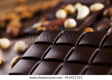Dark and milk chocolate bar on a wooden table