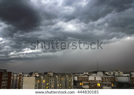 Dark and powerful storm clouds over the city - stock photo