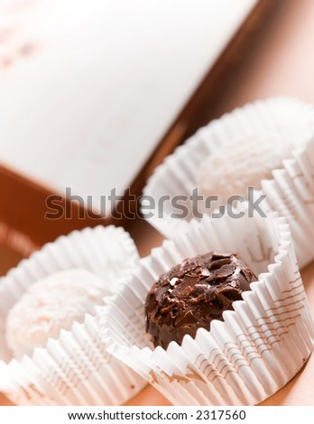 Dark and white chocolates with copy space, ready for tagging - stock photo