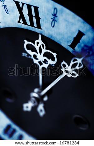 dark antique clock - stock photo