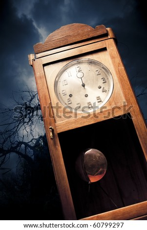 dark antique clock at Halloween night - stock photo