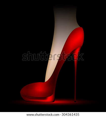 dark background and foot in a red ladys shoe - stock photo