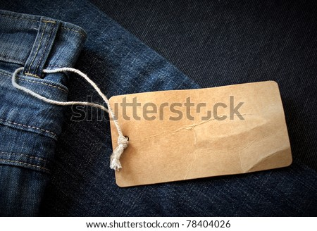 Dark background with paper jeans label/Jeans label - stock photo