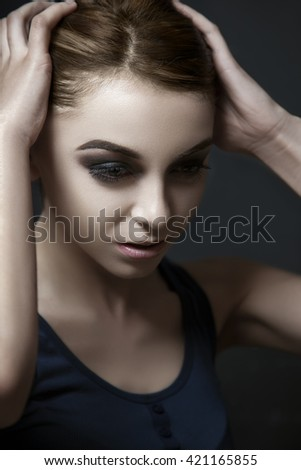 Dark beauty portrait makeup of an attractive young woman. - stock photo