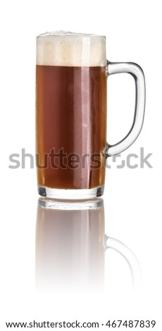 Dark beer in a beer mug on a white background
