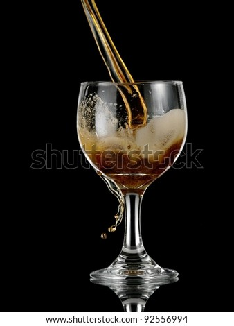 Dark beer pouring into a glass