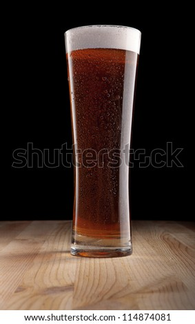 Dark beer with drops of moisture on the glass