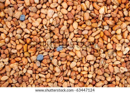 Dark blue and red brown small stone texture - stock photo