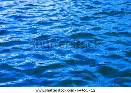 Dark blue background from a type on waves of a gulf of the river - stock photo