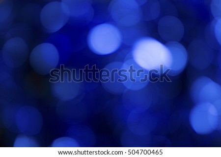 Dark blue bokeh background. Image with copy space.