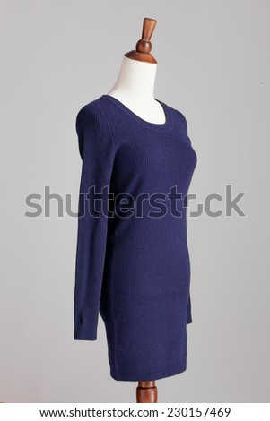 dark blue cashmere sweater with wood model on grey isolated