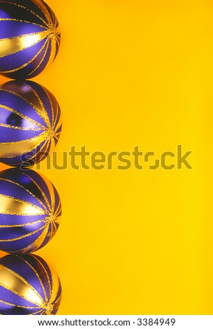 dark blue color New Year's balls on  yellow background lay in  number