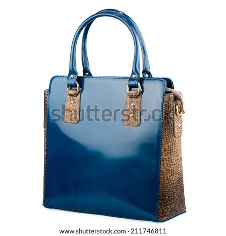 Dark blue female leather bag with reptile skin details isolated on white. - stock photo