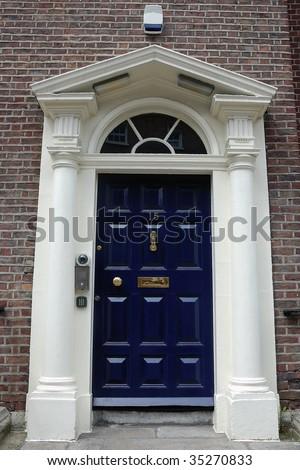 Dark blue front door in urban street stock photo